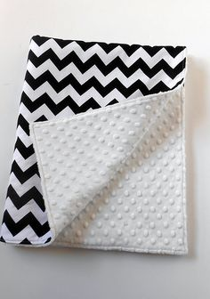 """Black and White Chevron Baby Blanket  Crib or toddler bed sized blanket. My blankets measure approx. 30""""X40"""", which is a nice size to fit in a crib, or for snuggling! The top fabric is 100% cotton, and they are backed with soft fleece minky.   These blankets do not have a filling, just two layers of fabric. Why? To provide a safe as possible blanket for your child, while still maintaining style and functionality. www.facebook.com/theurbantot"""