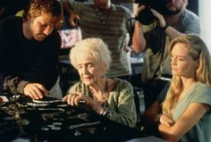 Titanic 1997 - On board the ship explorng the wreck of Titanic in search of her necklace known as 'Heart of the Ocean' older Rose is shown some items recovered from her stateroom by treasure hunter Brock Lovett played by Bill Paxton as Rose's granddaughter Lizzy Calvert played by Suzy Amis aka Mrs.James Cameron, looks on.