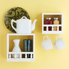 Cute storage for a small kitchen: These small shadow boxes come unfinished in sets of two. Use wood glue or nails to add a length of spindle railing along the bottom, and then paint each piece.