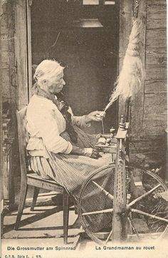 Grandmother spinning Switzerland. Notice the decorative work on the wheel