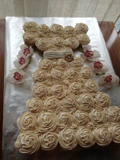 36 cupcakes decorated to match bridal gown.
