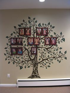 "Family tree wall in our playroom.  Tree decal from Etsy ""Decor Designs""…"