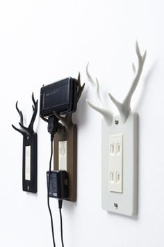...creative antler outlet plates to hold chargeable devices...