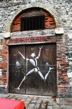 Wood door with painted figure. France
