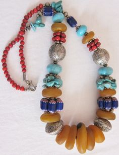 Berber Beads with Horn Turquoise Coral Color Beads by TuaregJewelry, $238.00 https://www.facebook.com/TuaregJewelry  Tuaregjewelry's Webshop: https://www.etsy.com/shop/TuaregJewelry by Ineke Hemminga