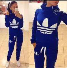 White On Royal Blue Adidas Sweat Shirt Hoodie & Jogger Styled Sweat Pants, Hoodie Has A Cute Zipper up/down Detail Opening Placed On Side Neck To Chest & The Shade Of Blue Is Sick Makes A Great Matching Sweat Suit