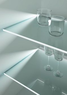 Toucan from DOMUS Line - a plastic LED lighting profile designed for glass shelving. Applied to frosted glass shelves, Toucan creates a diffused lighting effect across the entire shelf surface. Applied to transparent glass shelves, Toucan lights up the front edge only.