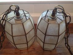 Hey, I found this really awesome Etsy listing at https://www.etsy.com/listing/293029497/vintage-capiz-shell-and-brass-swag-lamp