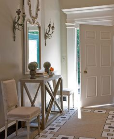 Honey Collins: Elegant foyer with tan chain link rug, Swedish console table, French square back linen ...