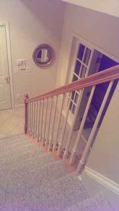 Iron baluster upgrade from M.C. Staircase & Trim. Removal of wooden balusters and installation of Versatile Series Plain Bar, Single Knuckles with accenting Feathered Scrolls in Satin Black.