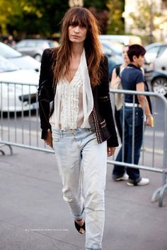 Street Style - Edgy black blazer with embellishments and ruffled blouse with loose fitting boyfriend jeans. The outfit has a boho feel.