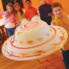 For each flying saucer, you'll need one 12- or 14-ounce paper bowl and 2 dinner-size paper plates (doubling the plates increases the craft's stability and helps it fly better). Look for standard-weight, slightly glossy plates and bowls.  Scissors  Double-sided foam tape