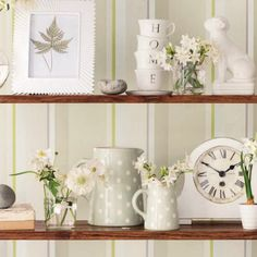Laura Ashley - bookshelf styling. This is so pretty, is like to throw some coral and turquoise objects in there too