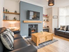 With an elegant colour palette and a log burner, the sitting room at Cartref Cottage is a stylish, calming and relaxing space. This holiday home is set in Keswick and sleeps with 2 pets welcome. Alcove Ideas Living Room, Living Room Shelves, Living Room Grey, Blue Feature Wall Living Room, Cosy Living Room Decor, Alcove Decor, Front Room Furniture Ideas, Victorian Living Room, Cottage Living Rooms