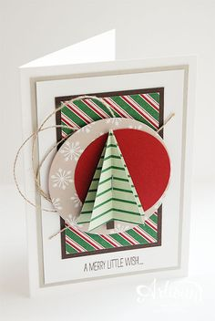 handmade Christmas card from Stampin 'Cards and Memories ... pretty patterned papers ... layered panel ... circle die cuts ... punched triangle tree with folded flaps ... bright mod look ...