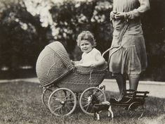 Unpublished childhood pictures of the Queen released to commemorate Prince George's birth ~  Princess Elizabeth sitting in a wicker pram, c.1928