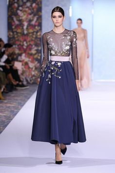 Navy silk faille skirt and sheer tulle body, embroidered with silk thread-work, sequins and glass beads in an organic floral design.