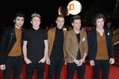 "Liam Payne Zayn Malik Photos - (L-R) Menbers of band ""One Direction"" Zayn Malik, Niall Horan, Liam Payne, Louis Tomlinson and Harry Styles attend the NRJ Music Awards 2013 at Palais des Festivals on January 26, 2013 in Cannes, France. - NRJ Music Awards 2013 - Red Carpet Arrivals"