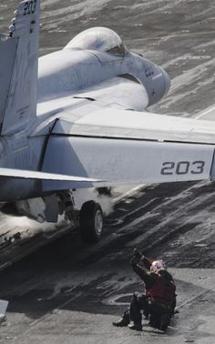 "MEDITERRANEAN SEA (Nov. 6, 2013) – An F/A-18E Super Hornet assigned to the ""Argonauts"" of Strike Fighter Squadron (VFA) 147 prepares to launch from the flight deck of the aircraft carrier USS Nimitz (CVN 68). Nimitz is deployed supporting maritime security operations and theater security cooperation efforts in the U.S. 6th Fleet area of operations. (U.S. Navy photo by Mass Communication Specialist 2nd Class Jacquelyn D. Childs/ Released)"