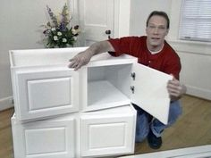 Build a window seat from wall cabinets. What