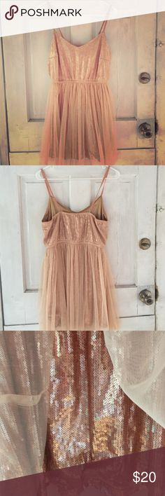 Forever 21 bronze dress This beautiful spaghetti strap dress is covered with bronze sequins with a cream colored sheer fabric covering. Has elastic on the waist to show off those curves. Great for New Years or Christmas Party! It's a medium but fits more like a large. Forever 21 Dresses