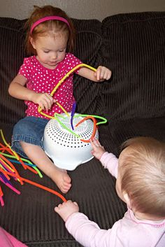 Quite fun activity...pipe cleaners.  I am not a stay at home mom, but I love her activities to do with my little one at night on the weekends!