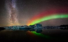 Iceland Aurora and the Milky Way. We could sit in the oceanic hot springs and touch the sublime.