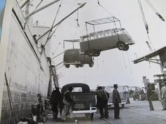 Buses being unloaded from a ship