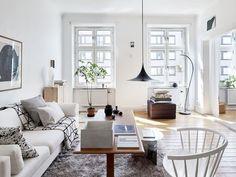 Sitting room in a monochrome Swedish home with lovely light/ Kvarteret Mäkleri