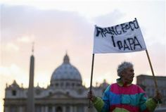 A man holds a banner reading 'Francesco I Papa' in front of Saint Peter's Square at the Vatican March 11, 2013. Roman Catholic Cardinals will begin their conclave inside the Sistine Chapel on Tuesday to elect a new pope. REUTERS-Alessandro Bianchi (VATICAN - Tags: RELIGION)