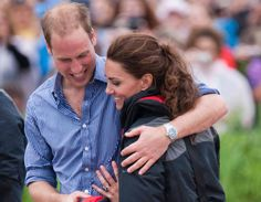 William hugs Kate after competing against her in a rowing competition in Canada during their royal visit to the USA and Canada on 4 July 2011