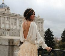 This bohemian look with the open back dress and braided updo is so romantic and fairy-tale like