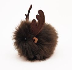 Hi, my name is Randyand I am a Fuzziggle. My fur is brown and my antlers are made of wool felt.I only come in a small size,about 4x5 inches, however myantle