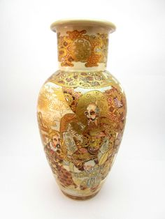 Antique 19th Century Meiji (1868-1912) Japanese Satsuma vase painted with scholars and flowers.