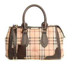 Burberry Gladstone Tote Bag £799.00 A Burberry checked patterned bag. Dark chocolate calf grainy leather trims and attachments. A top zip closure. Dark chocolate leather handles and adjustable strap. Four gold metallic protective base studs with dark chocolate canvas inside. One inner zipped pocket with a stamped leather logo. Two sided inner pockets. Made in Italy.