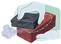 Charcoal is the ideal soldering surface because it absorbs oxygen, which causes oxidation on metal. However, in a short time the flat surface of a charcoal block deteriorates and even though it is still funtional for some tasks, it is no longer suitable for assemblies that require a flat surface.   Brick, cinder block, and concrete are perfect grinding surfaces for charcoal. Simply place the block on the abrasive and rub it in a circle.