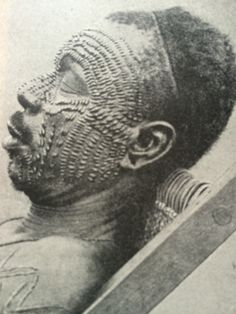 Ngombe People, The Congo. A man with facial scarification.