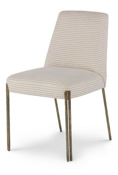 KELLY WEARSTLER | MELANGE DINING CHAIR/ Sublimely elegant upholstered seating with wrought tubular brass legs.