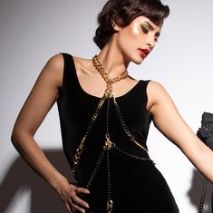 Egyptian inspired futuristic body chain. Armor jewelry gold. This edgy statement bondage chain harness is designed with black and gold chains. Modern cleopatra style, for real fashion goddesses! #statement #futuristic #cleopatra #edgy #scifi #elegant #goldjewelry #jewelryinspiration #bodychain #bodynecklace #bondage #bdsm