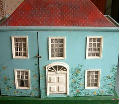 Triang 'Queen Anne' 1950s dolls house, almost identical to one I had in the 1970s.