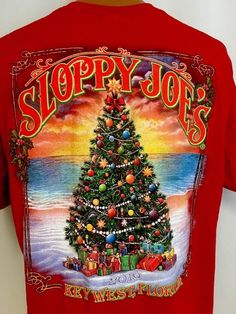 "Christmas Themed Sloppy Joe's T-Shirt from Key West, Florida 2016 in size Men's XL. Armpit to armpit - 24"" across, 48"" doubled; total length - 31"". 