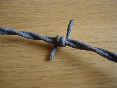 Fake Barb Wire http://www.instructables.com/id/How-to-make-cheap-fake-barb-wire/step3/Making-the-barbs/