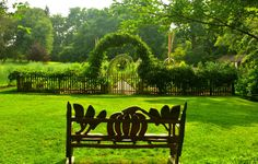 Early evening and the vegetable bench beckons to rest and enjoy the view through the Vegetable and Cut Flower Gardens. <h6>Photo by Dennis Matthews</h6>