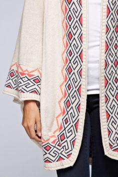 Was not aware this is a poncho.  Pattern/colors cute, no ponchos.  RELISH CLOTHING www.relishclothing.com