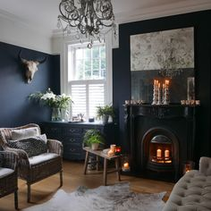 Love the play of opposing styles in this room. The dark navy wall makes the light wood flooring and white ceiling stand out. The horned animal skull is perfect in its juxtaposition with the glamorous chandelier. Also the casual/coastal seating in the chairs and couch balance out the glamor of the room⁠ .⁠ .⁠ .⁠ .⁠ .⁠ .⁠ .⁠ .⁠ #moodfurnitureau #coastal #coastalliving #skull #chandelier #interiordesign #homedecor #interiors #livingroom #bedroom #darkwalls #styleitdark #darkinteriors Outdoor Fireplace, Build Outdoor Fireplace, Backyard Fireplace, Decor, Living Room With Fireplace, House, Elegant Living Room, Dream Decor, Fireplace