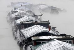 Snow-covered boats on the Huai'an section of China's Grand Canal
