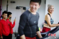 """""""Yoga Granny"""" sets example for bodybuilders with decade in the gym  Photos capturing an older lady undertaking a variety of physical fitness programs with sheer vigor have taken China's social media by storm.  One may well be shocked to discover the age of the woman, given her radiant face, tidily groomed hair, and long, slender legs with muscles defined through a decade of physical exercise."""