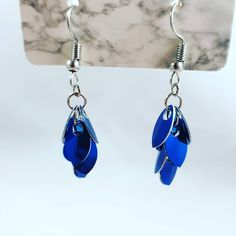 The scales are made from aluminium making the earrings very lightweight and comfortable to wear. The rings and base of the earrings are from stainless steel. Item is ready to ship Renaissance Fair Costume, Renaissance Jewelry, Blue Earrings, Dangle Earrings, Gifts Under 10, Geek Gifts, Chainmaille, Dangles, Stainless Steel