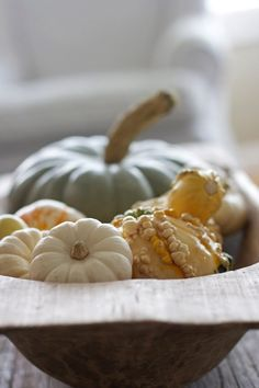 The easiest fall wedding DIY table decor ever. Some pretty bowls from the thrift store filled with miniature pumpkins. Done! (Nestle a little votive candle in the bowl for extra glow.)
