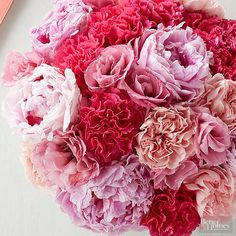 Create a lush wedding bouquet with a tight blend of carnations, peonies and roses.